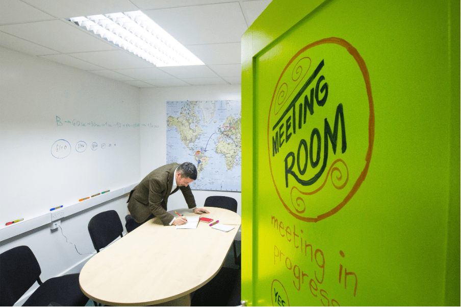 Meeting room with Smarter Surfaces Whiteboard Paint Clear on the door and Whiteboard Paint White on the walls