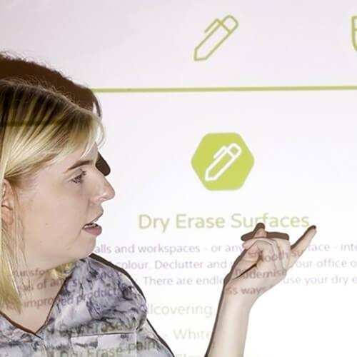 woman using smart projector paint pro in presentation