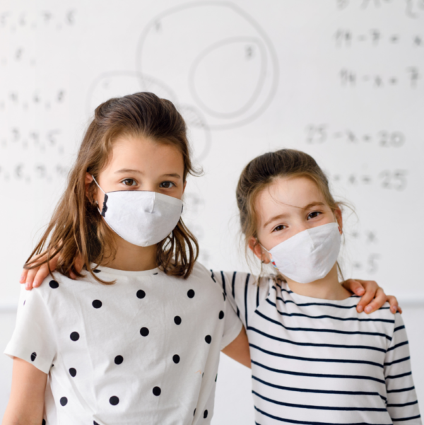 two children standing infront of Smart Antimicrobial whiteboard paint